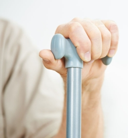 54379717 - hand of senior man holding on to a cane